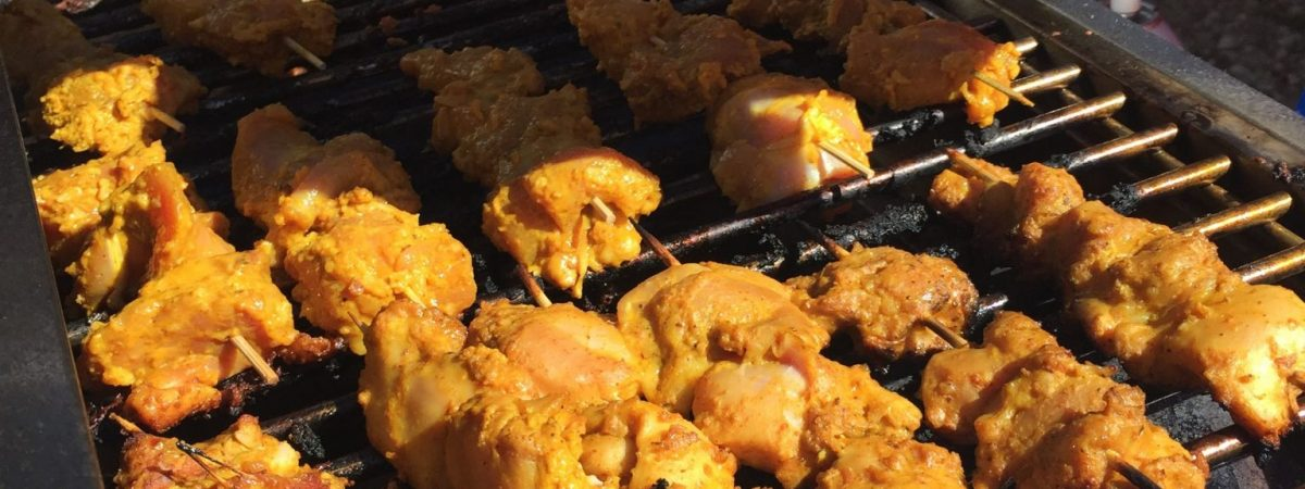 Grilling chicken at the Cary Downtown Farmers Market