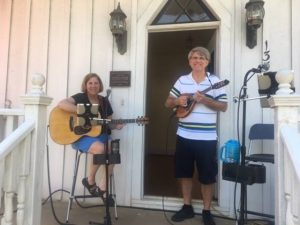 The band, CityFolk, performing on the front porch of the Ivy-Ellington House