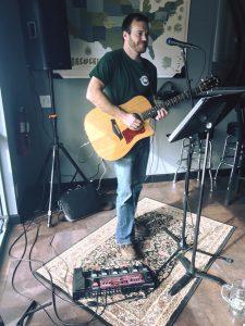 Tom Neuhauser playing guitar