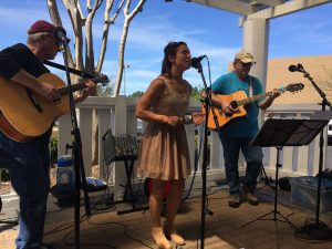 "The band ""Loos Change"" performing on a porch"